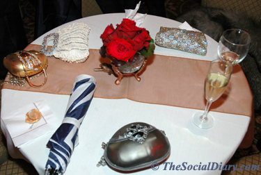 reception table for charity ball with pretty purses strewn about