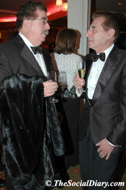 dr. richard greenfiield and leo zuckerman chatting over champagne