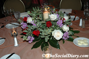 charity ball dining table setting with floral arrangement