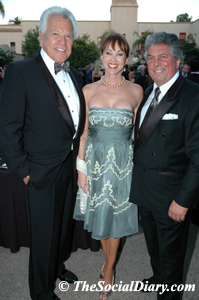 don cohn with denise and bertrand hug
