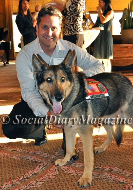Jim Silvera of Rancho Coastal Humane Society with military rescue dog Chyba
